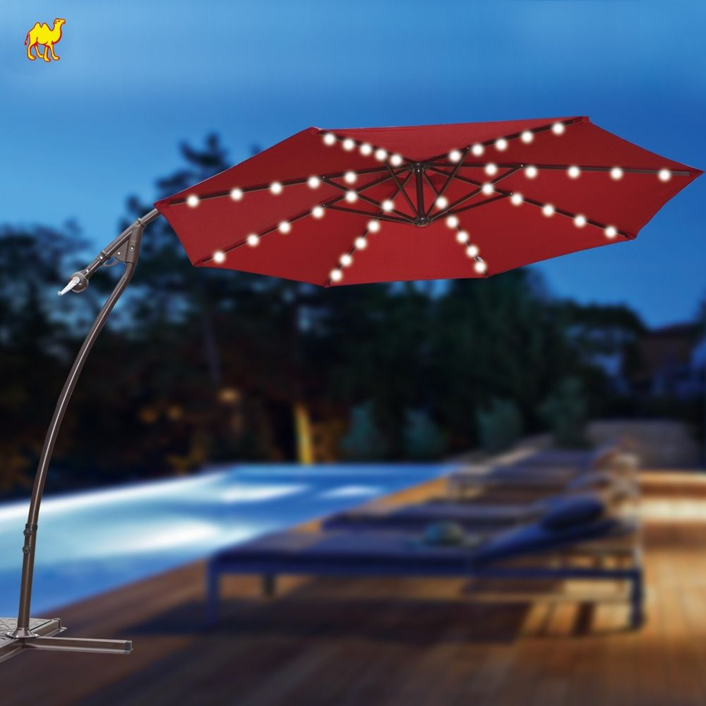 red cantilever patio umbrella with metal stand plus lighting for patio decor ideas