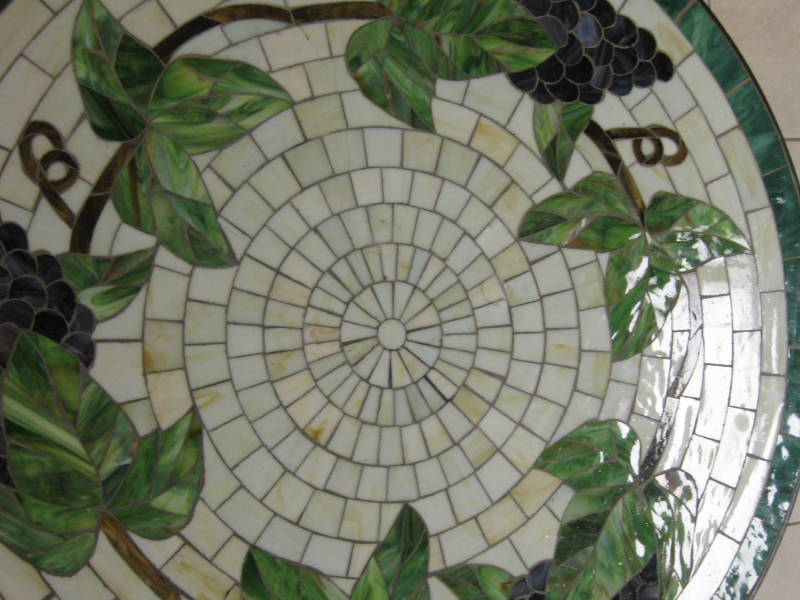 Round Mosaic Bistro Table With Leaf Motif For Home Furniture Ideas
