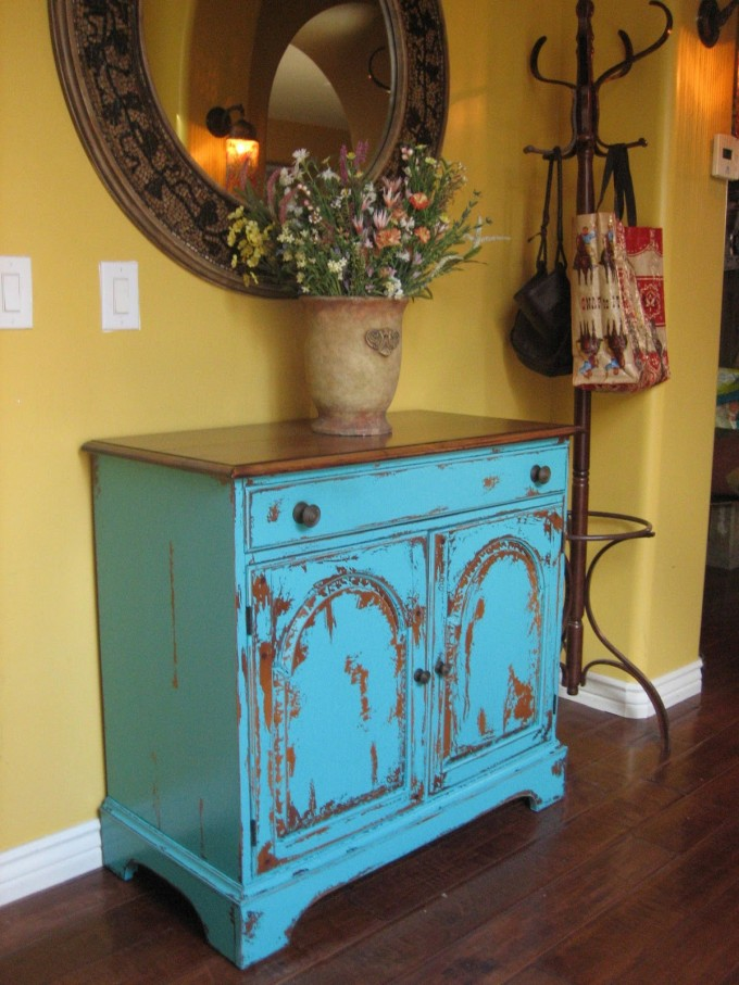 Rustic Turquoise Nightstand With Brown On Top On Wooden Floor Under The Round Mirror For Home Decor Ideas