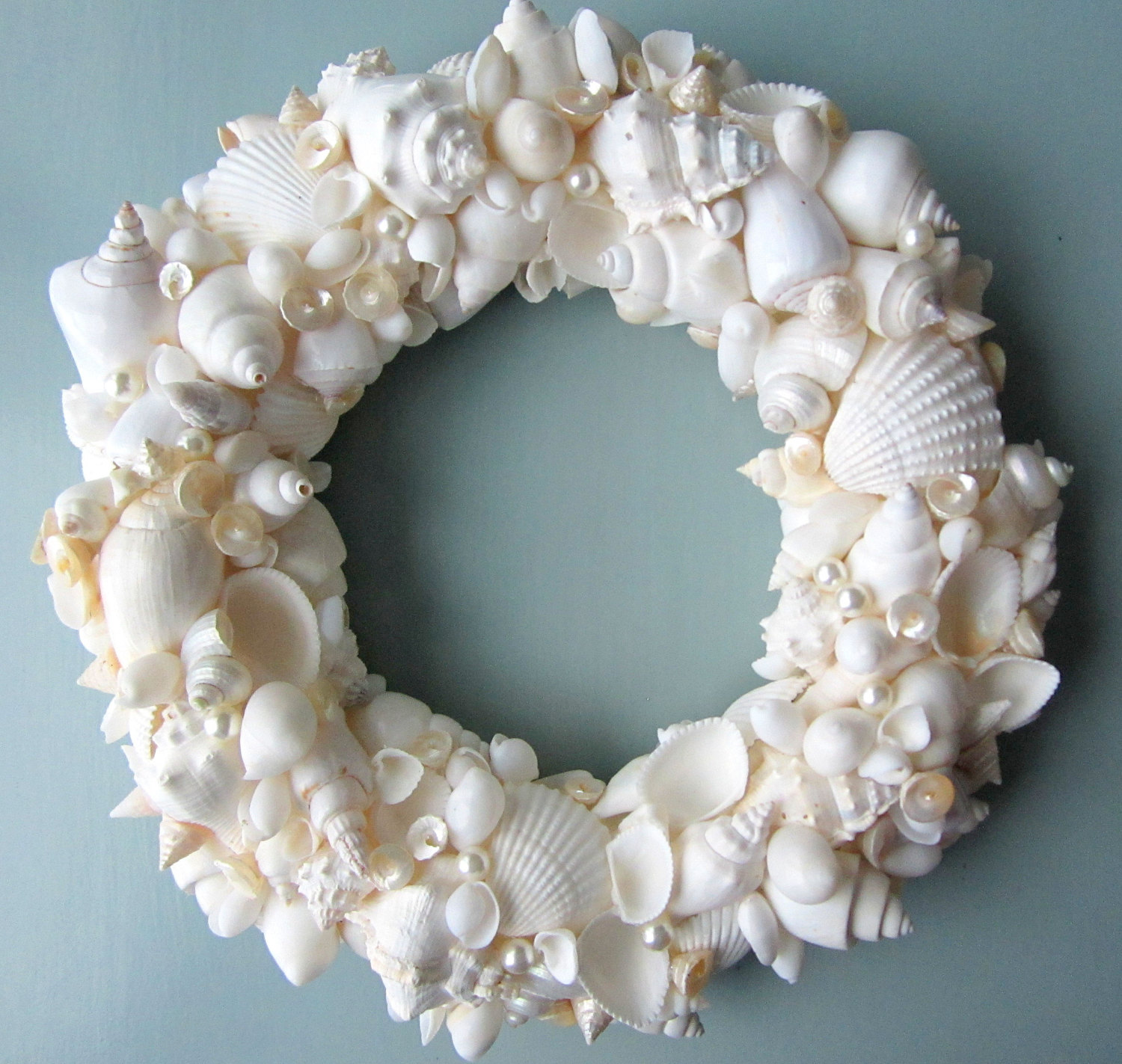 Seashell Wreaths In White On Blue Wall For Wall Decor Ideas