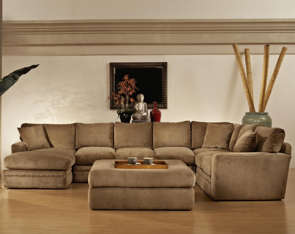 living room wood furniture. sectional sleeper sofa in tan plus ottoman on wooden floor matched with  white wall for living Decorating Comfortable Sectional Sleeper Sofa For Living Room