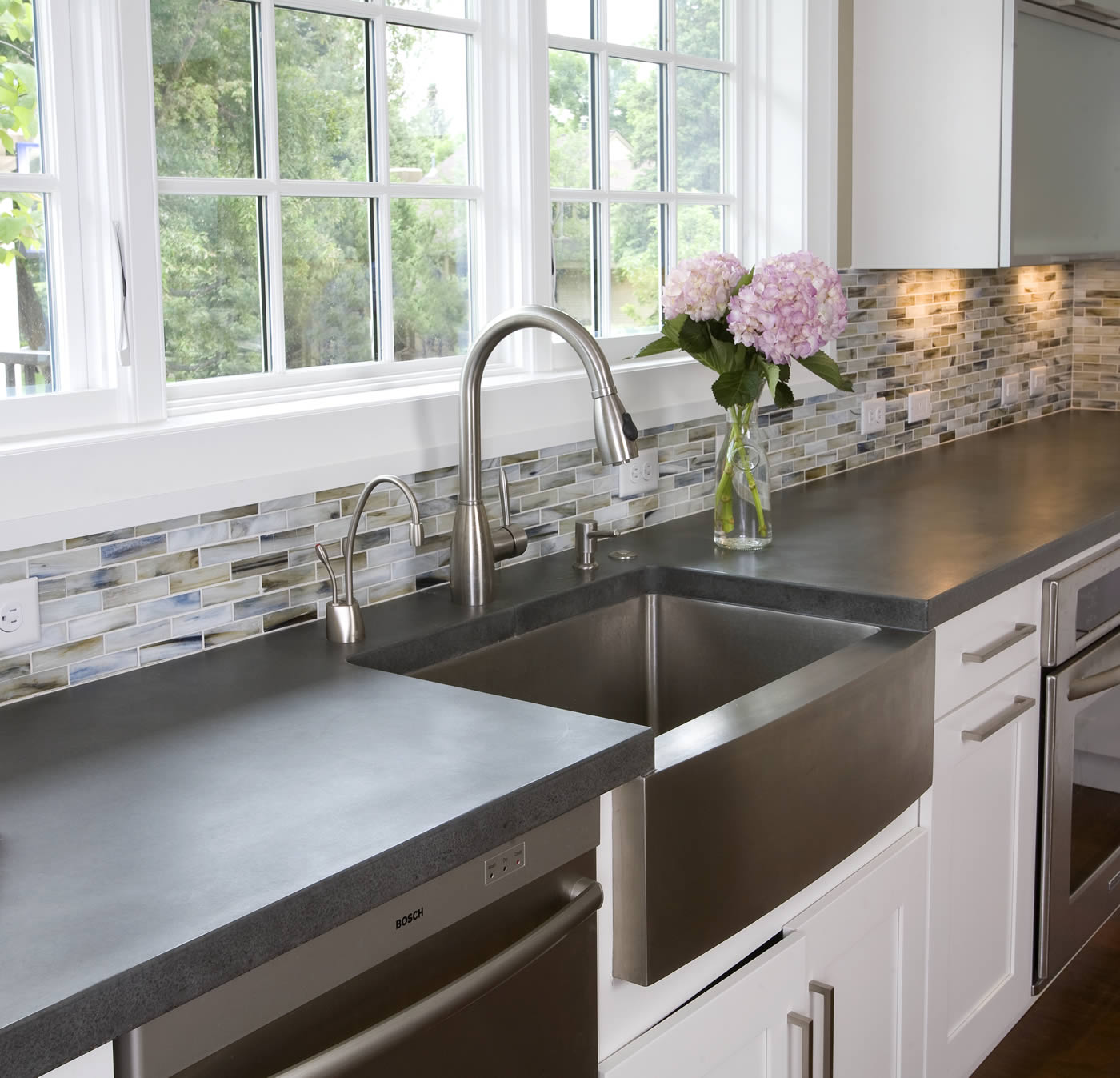 single rectangle stainless steel apron sink on white kitchen cabinet with silver handle and grey countertop plus silver kitchen faucet under the white window for kitchen decor ideas