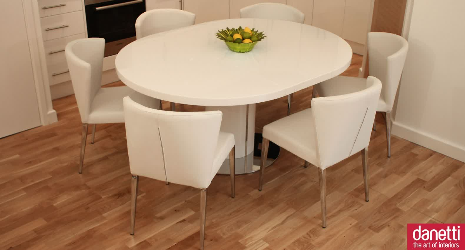 solid white expandable dining table set with round table on wooden floor for dining room ideas