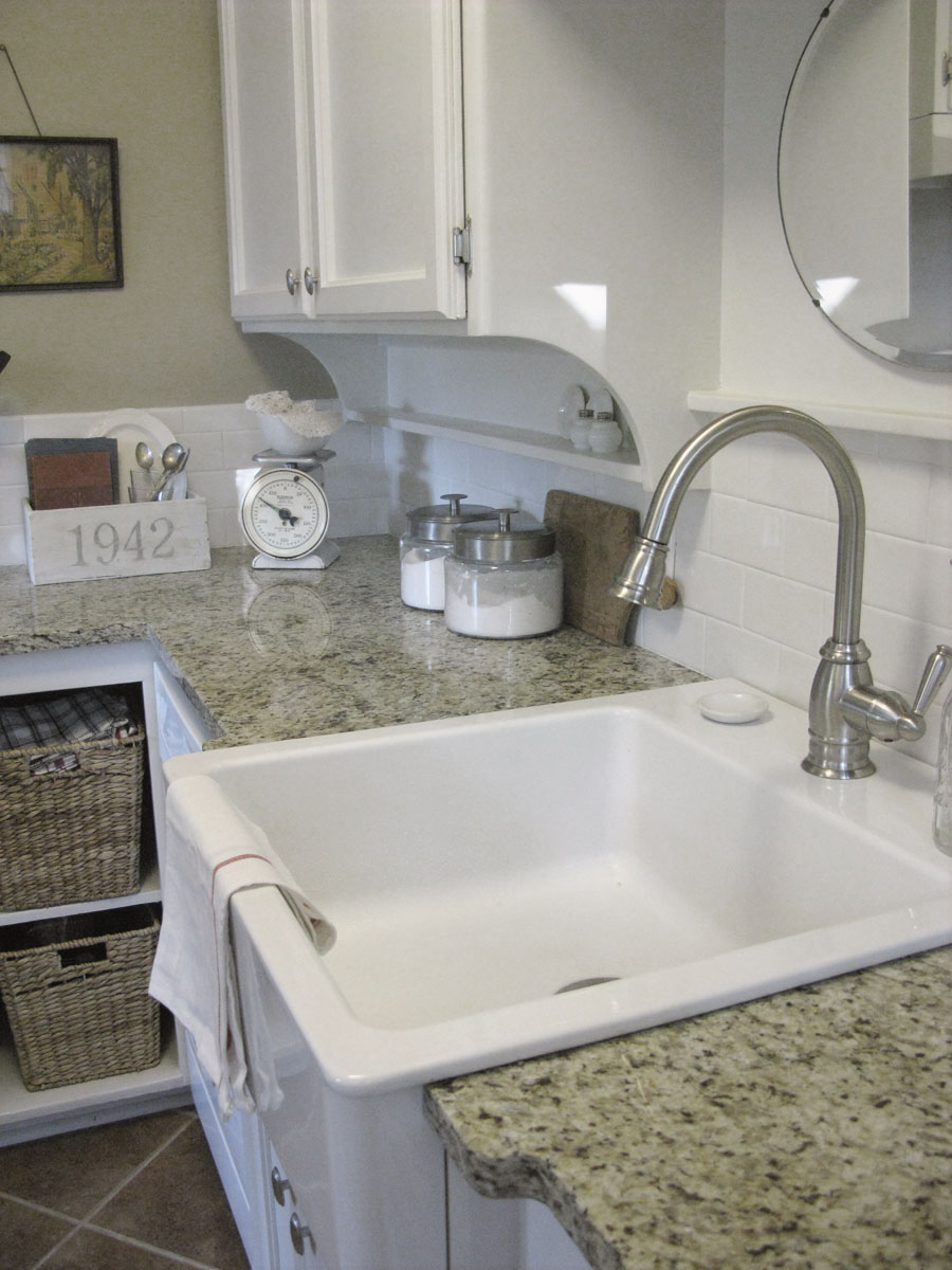 square white apron sink plus silver faucet on wheat marble countertop with white back splash for kitchen decor ideas