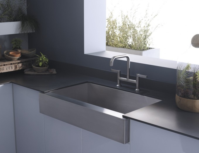 Stainless Steel Apron Sink Plus Silver Faucet On Black Countertop For Kitchen Decor Ideas