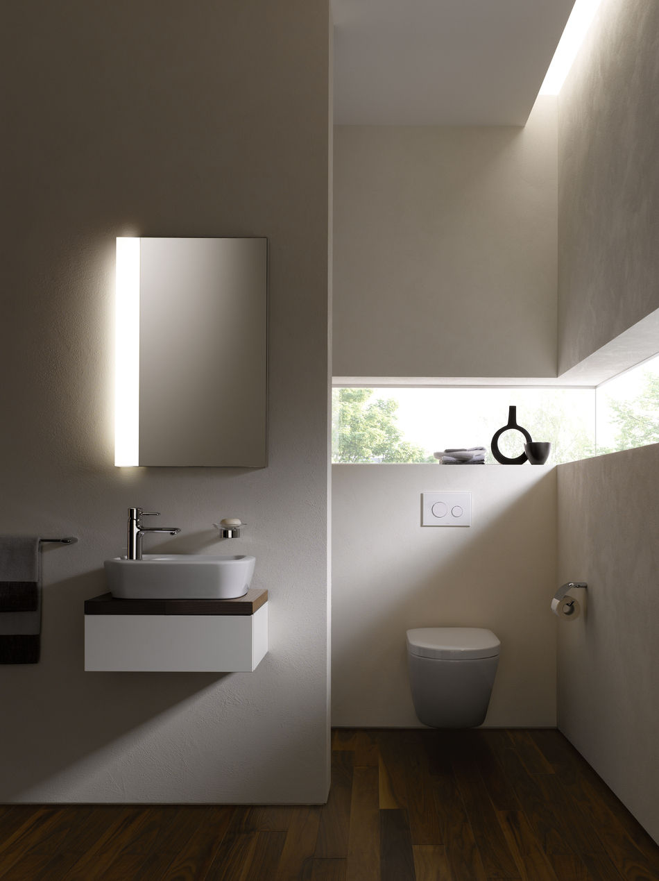 Suspended toilet NC SERIES TOTO toilets Europe GmbH on patched on white wall on the bathroom with wooden floor plus sink and mirror with light ideas