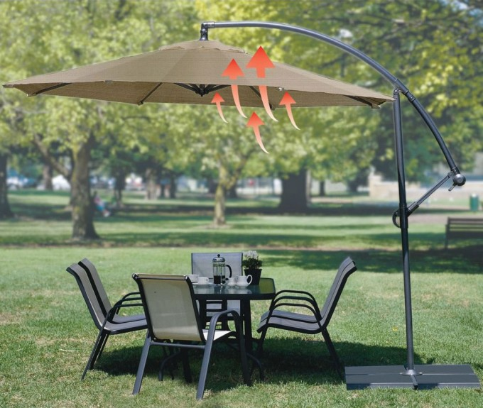Tan Cantilever Patio Umbrella With Black Metal Stand Plus Dining Table Set For Patio Decor Ideas