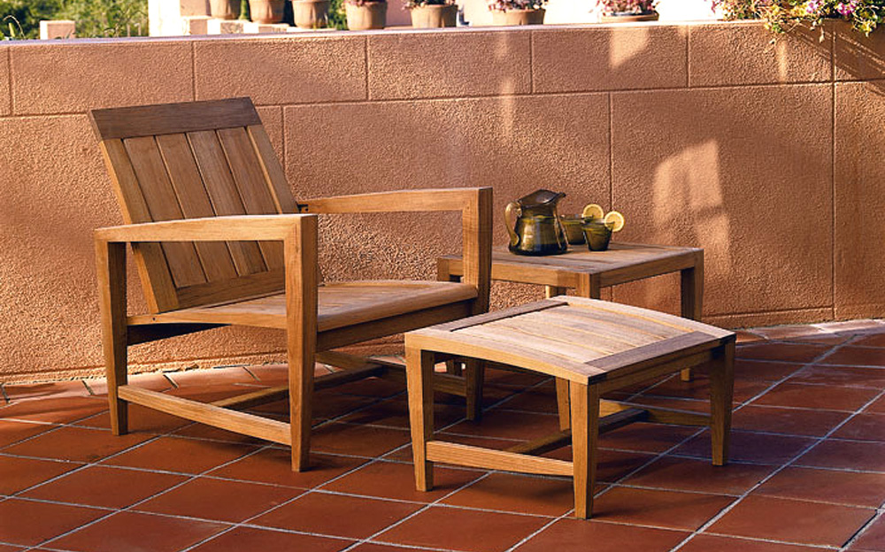 Teak Adirondack Chairs with ottoman and table on brown ceramics floor for patio decor ideas