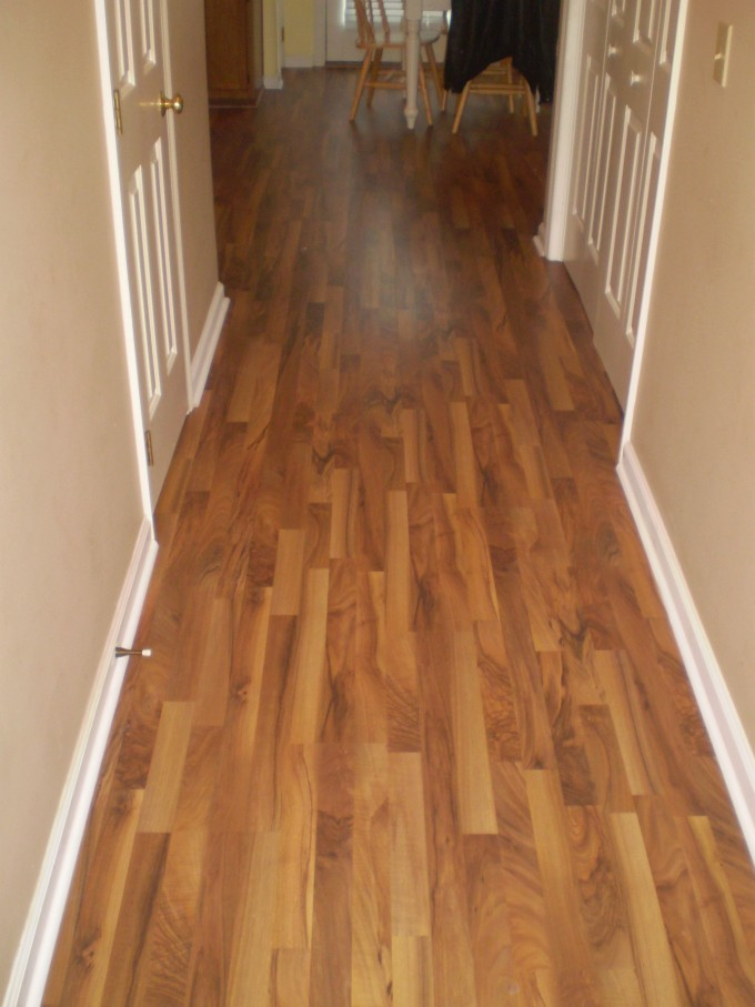 Teragren Flooring Matched With Beige Wall With White Baseboard Molding For Home Interior Design Ideas