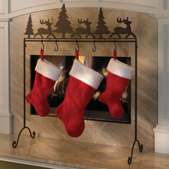 The Portable Metal Christmas Stocking Hanger In Brown In Front Of The Fire Place