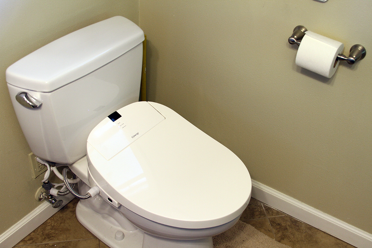 Toto toilets on brown ceramics floor matched with tan wall plus white baseboard molding plus rolled tissue for bathroom decor ideas