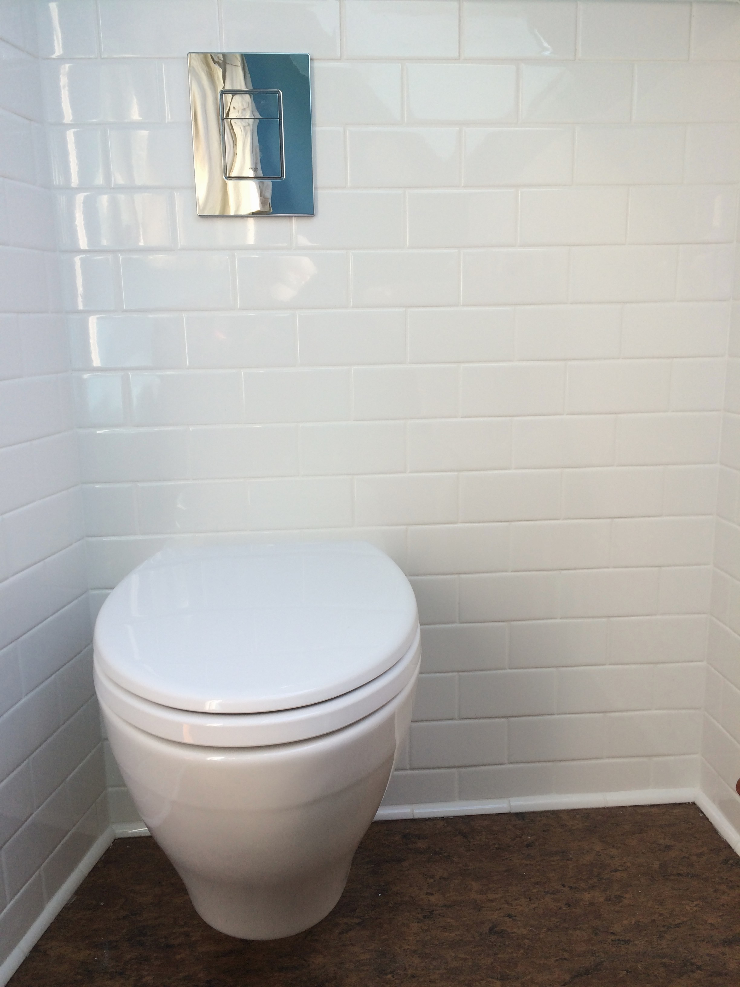 Toto Toilets on brown floor matched with white bricked wall for inspiring toilet decor ideas