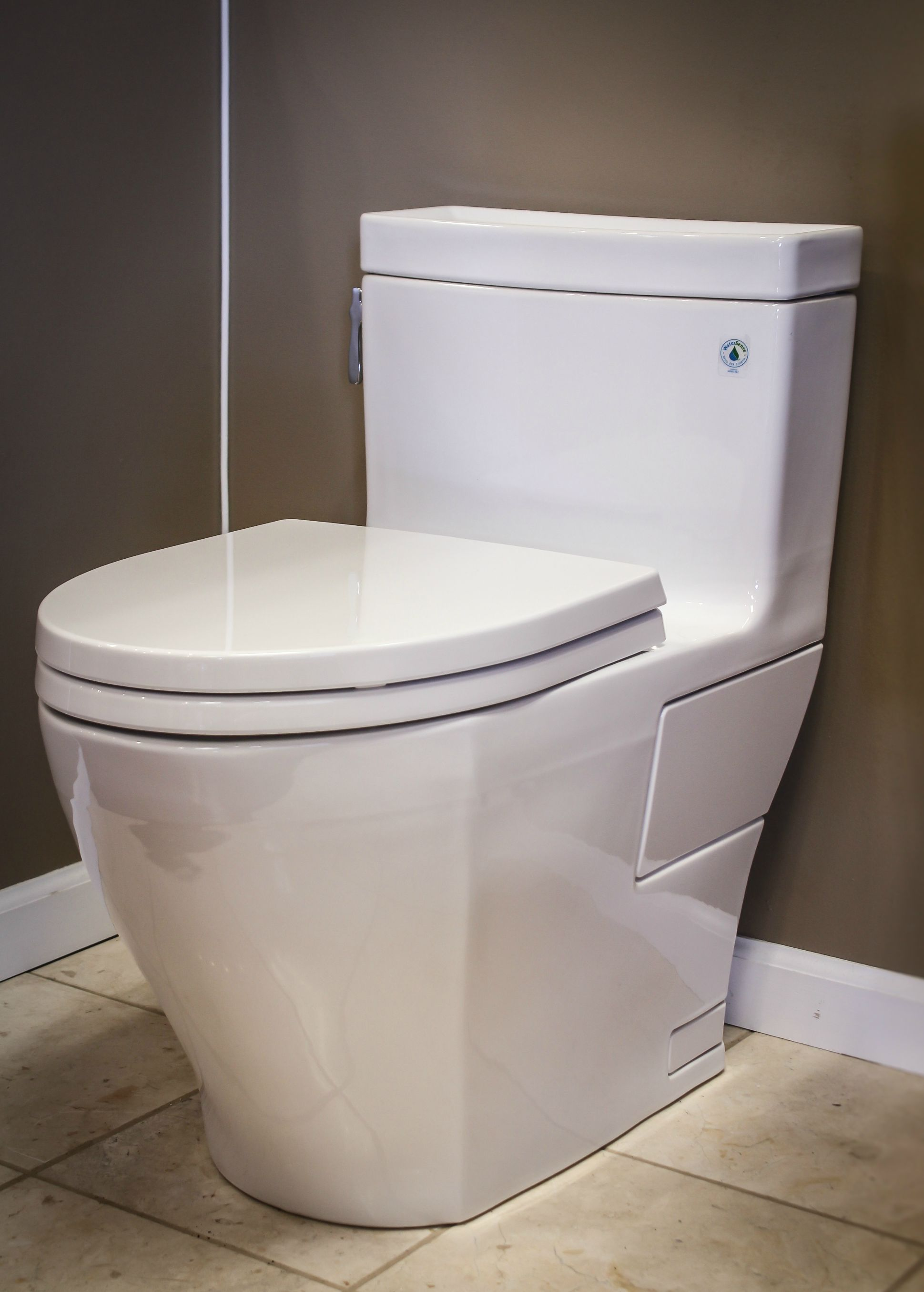 Toto Toilets On Cream Ceramics Floor Matched With Dim Grey Wall And White Baseboard Molding For Toilet Decor Ideas