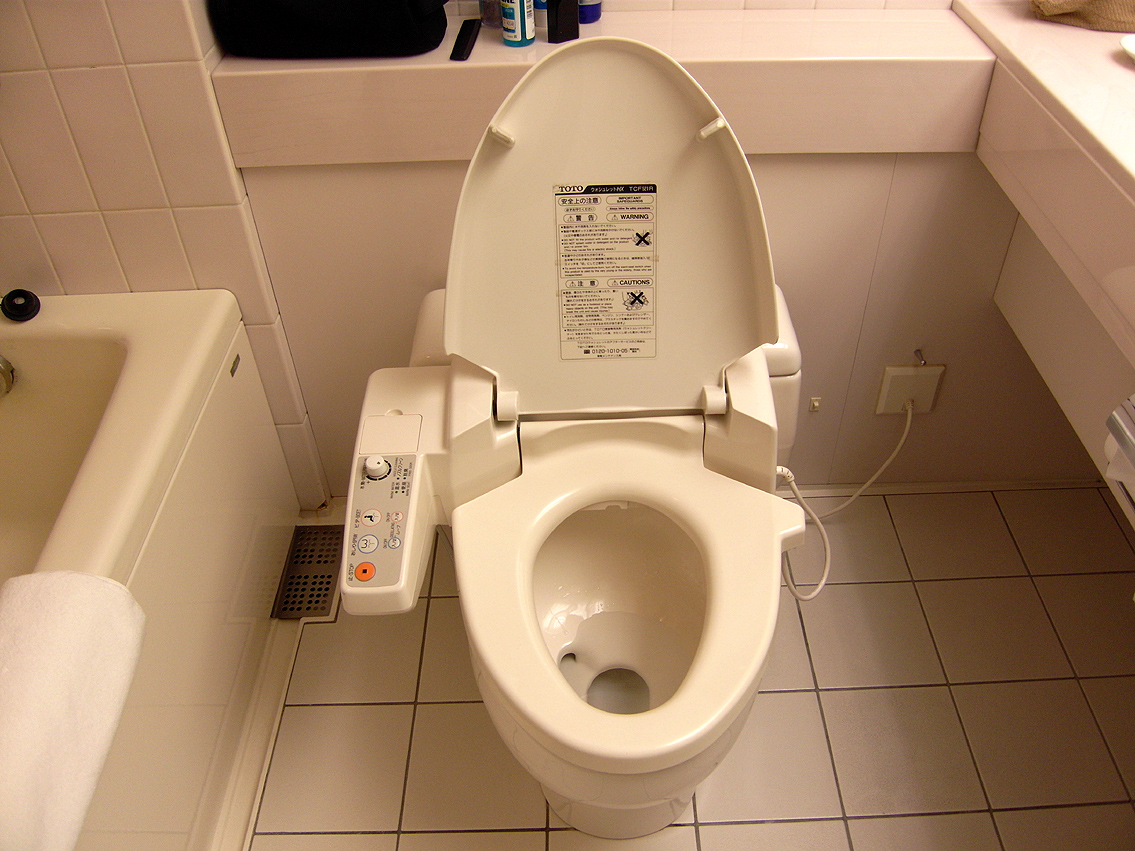 TOTO Toilets With Button Washlet On White Ceramics Floor For Toilet Decor Ideas
