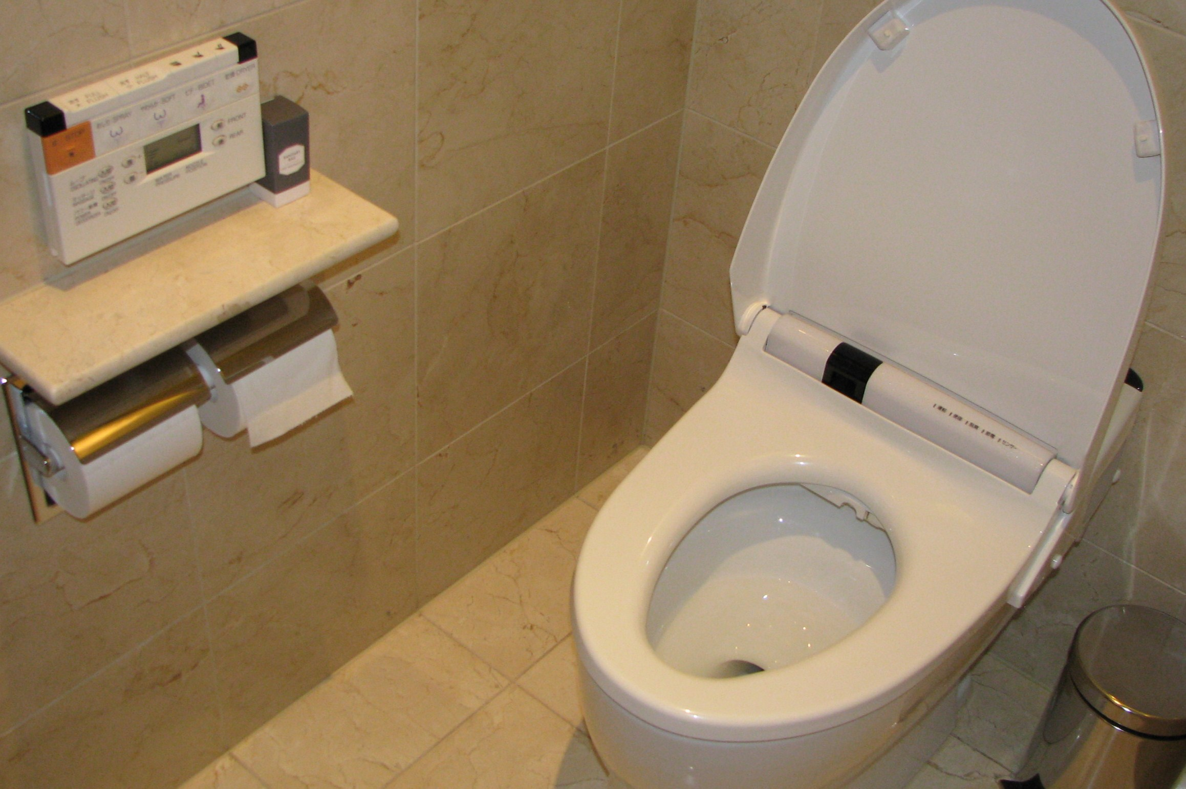 Toto Toilets with Washlet Feature a Standard on cream ceramics floor matched with cream ceramics wall plus rolled tissue for toilet decor ideas