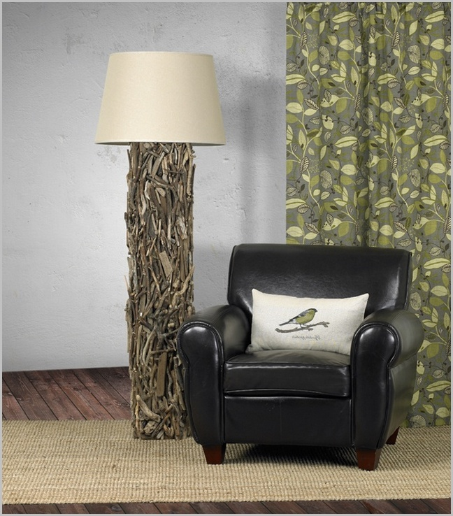 unique driftwood floor lamp plus black leather single sofa on wooden floor with mocca carpet for living room decor ideas
