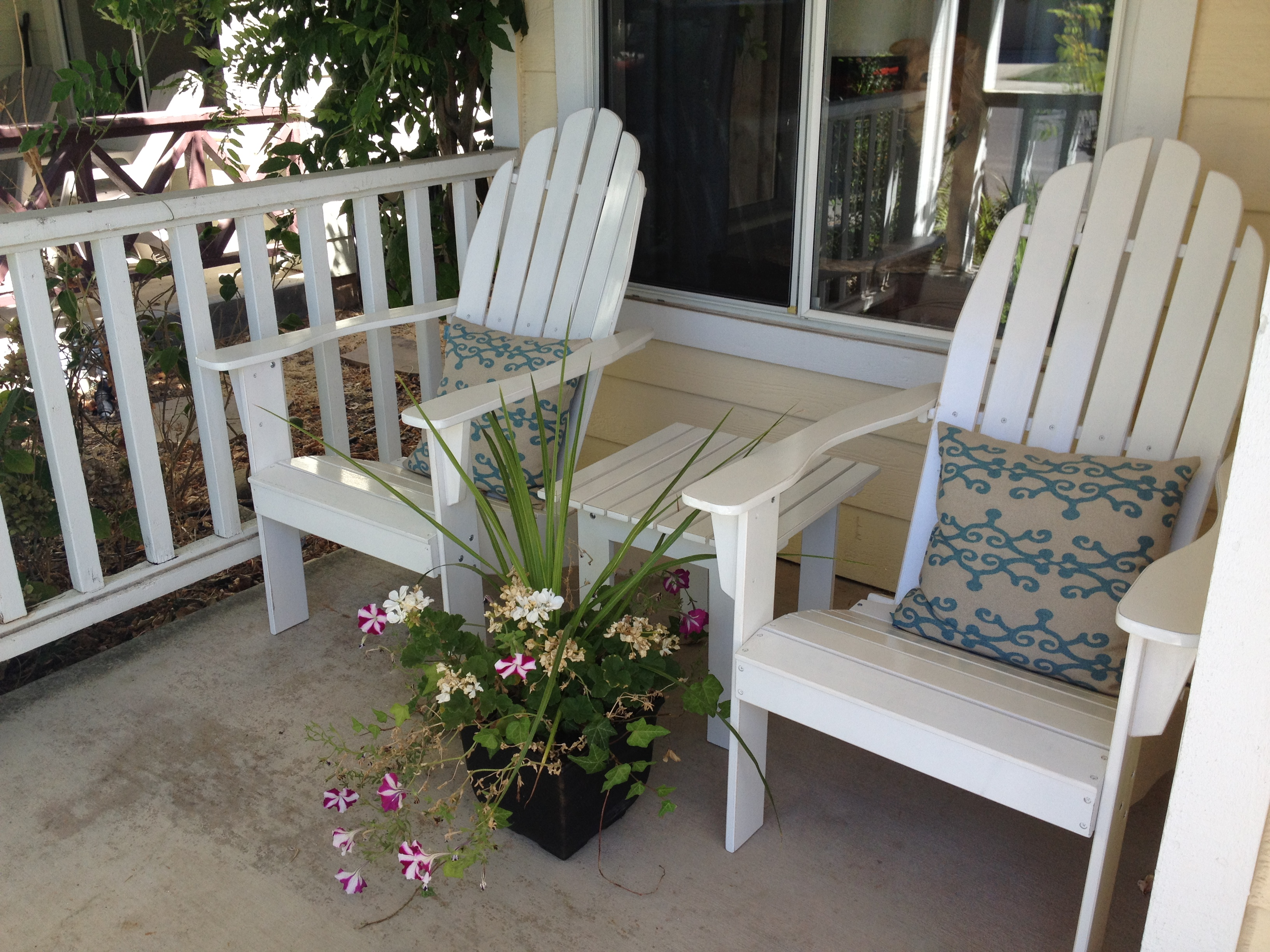 unique teak adirondack chairs in white plus cushion on tan flooring for patio decor ideas