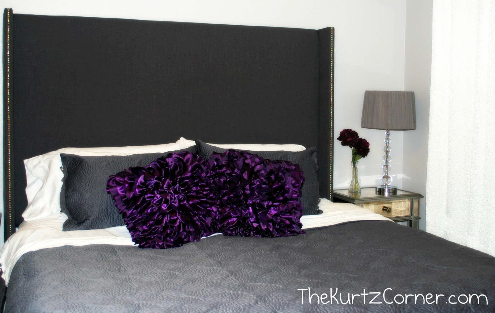 upholstered headboards in black matched with gray bedding plus nightstand and table standing lamp for bedroom decor ideas