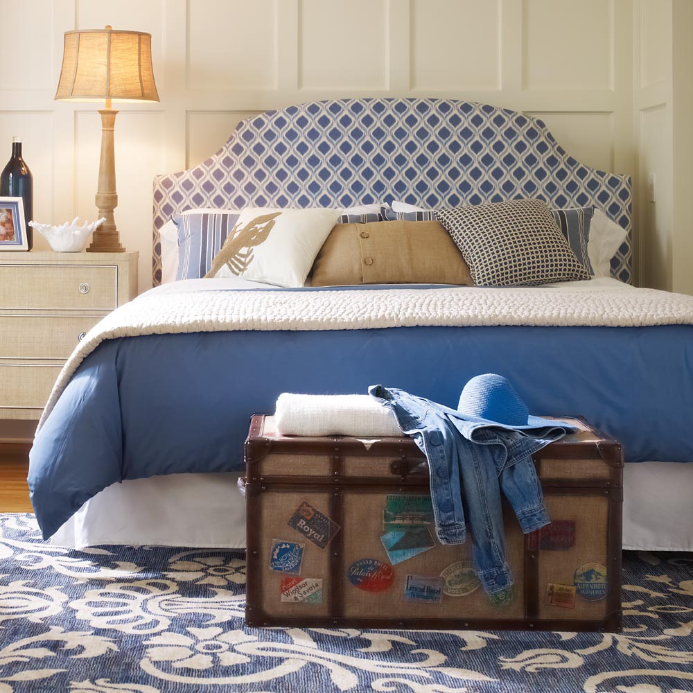 upholstered headboards in blue and white matched with blue and white bedding plus white nightstand and table standing lamp for bedroom decor ideas