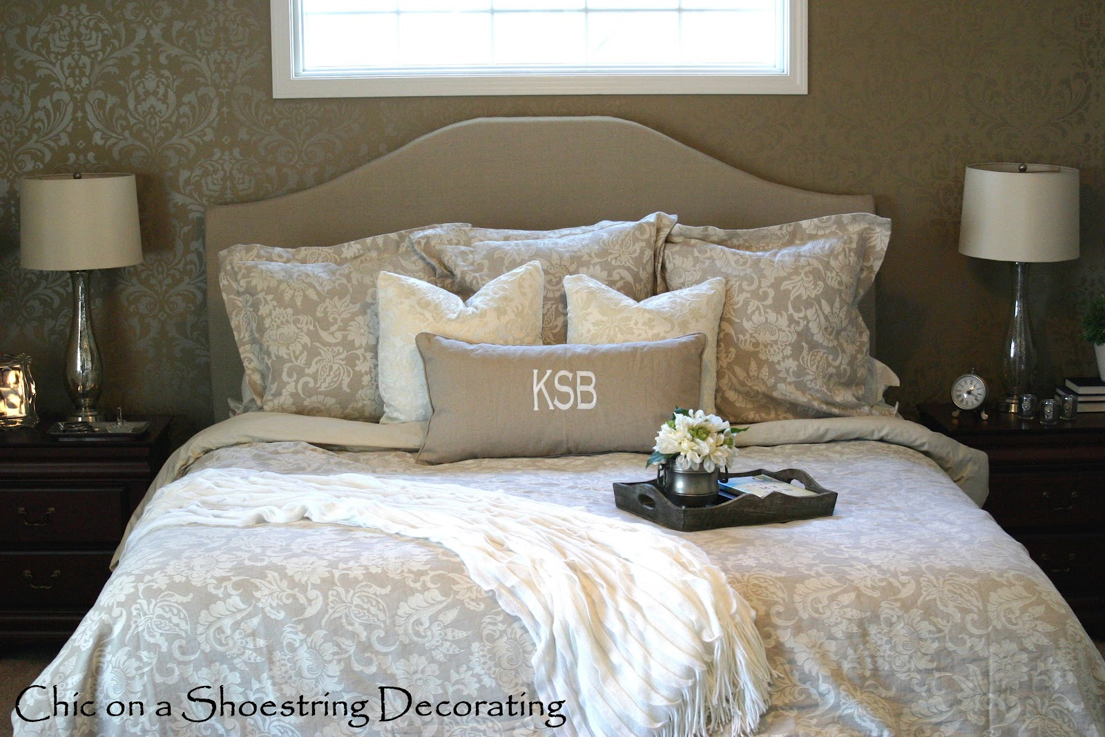 upholstered headboards in gray with floral bedding before the floral wallpaper for bedroom decor ideas