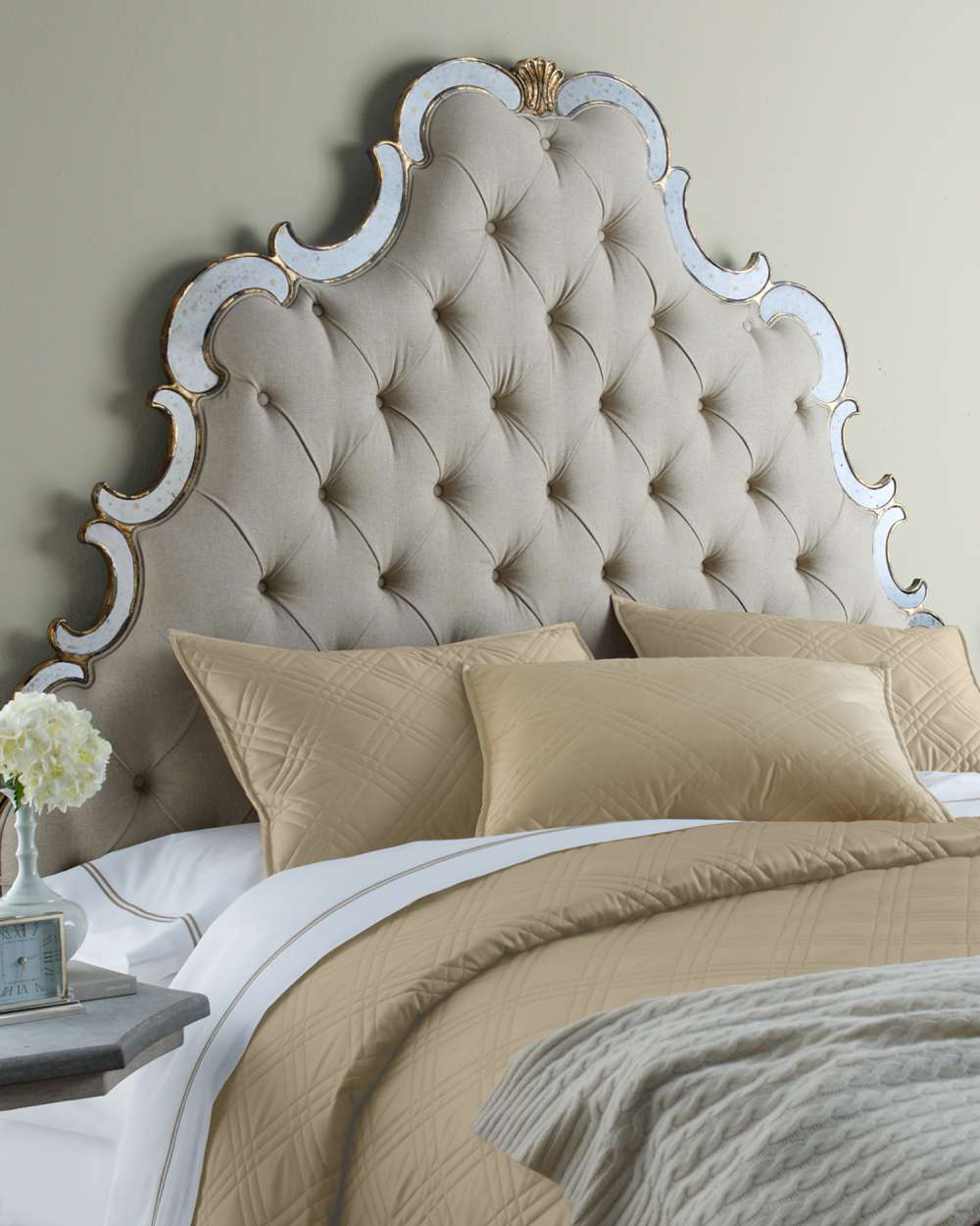 Upholstered upholstered headboards in beige with tab bedding and nightstand before the beige wall for bedroom decor ideas