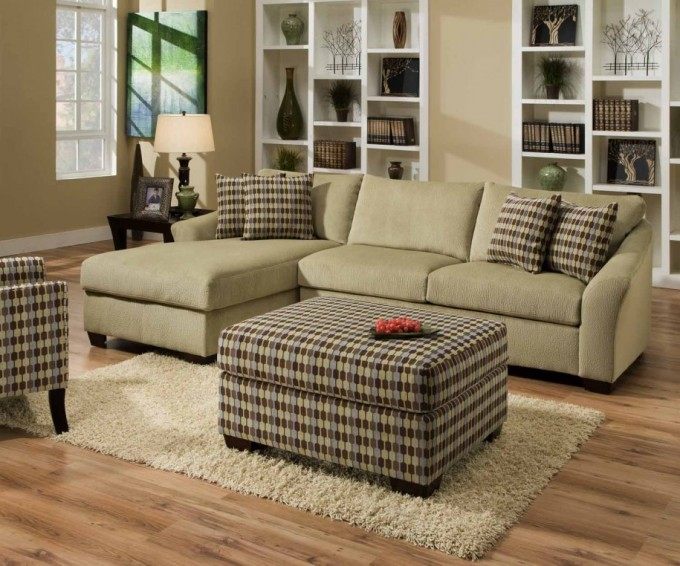Wheat Sectional Sleeper Sofa Plus Ottoman On Wooden Floor Plus Wheat Carpet Matched With Cream Wall For Living Room Decor Ideas