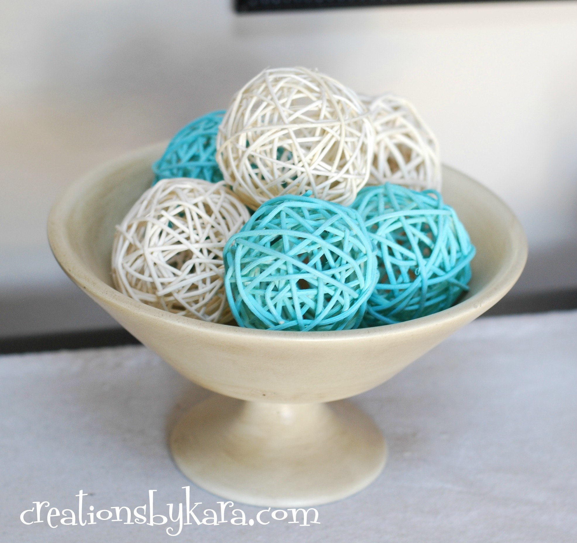 white and blue decorative orbs on wheat bowl for table accessories ideas