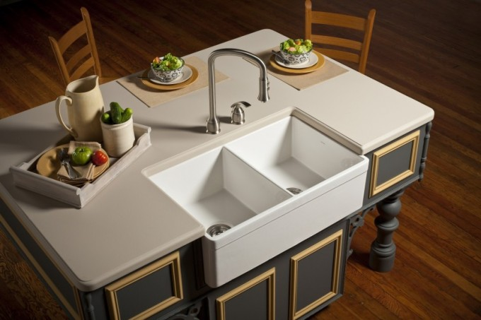 White Apron Sink Plus Silver Faucet On Black Wooden Cabinet With White Countertop For Kitchen Decor Ideas