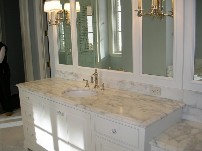 White Bathroom Vanities With Tops And Single Sink And Faucet Before The Tile Wall With Mirror And Lighting For Bathroom Decor Ideas