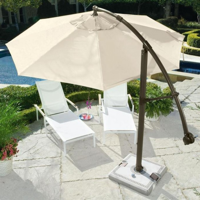 White Cantilever Patio Umbrella With Brown Stand Plus White Sofa For Patio Decor Ideas