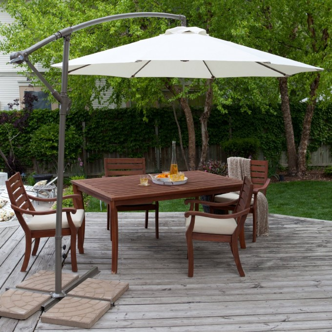 White Cantilever Patio Umbrella With Grey Stand Plus Wooden Dining Table Set For Patio Decor Ideas