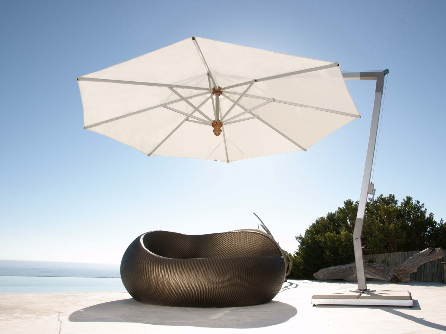 white cantilever patio umbrella with metal stand and single round sofa for patio decor ideas