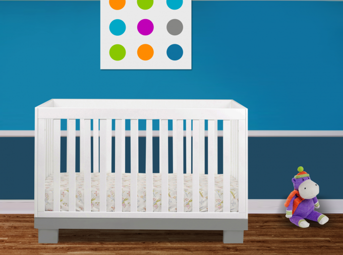 White Crib By Babyletto On Wooden Floor Matched With Blue Wall For Nursery Decoration Ideas