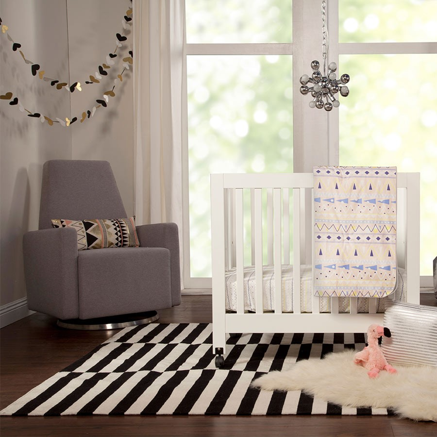 White Crib By Babyletto On Wooden Floor Plus Black And White Striped Carpet Plus Grey Single Sofa For Nursery Furniture Ideas