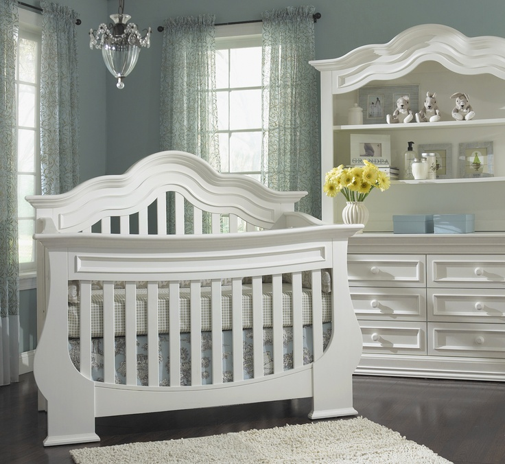 white munire crib on wooden floor plus white carpet matched with soft blue wall plus white vanity for nursery decor ideas