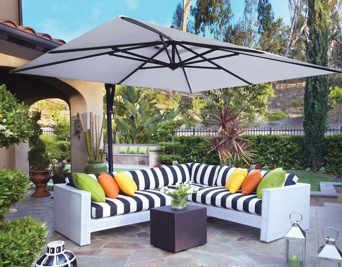 white rectangular cantilever patio umbrella and sofa with stripped seat plus black small table for patio decor ideas