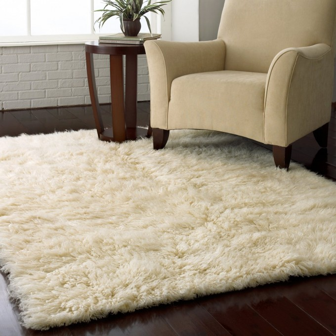 White Shag Rugs On Wooden Floor Plus Single Sofa For Living Room Decor Ideas