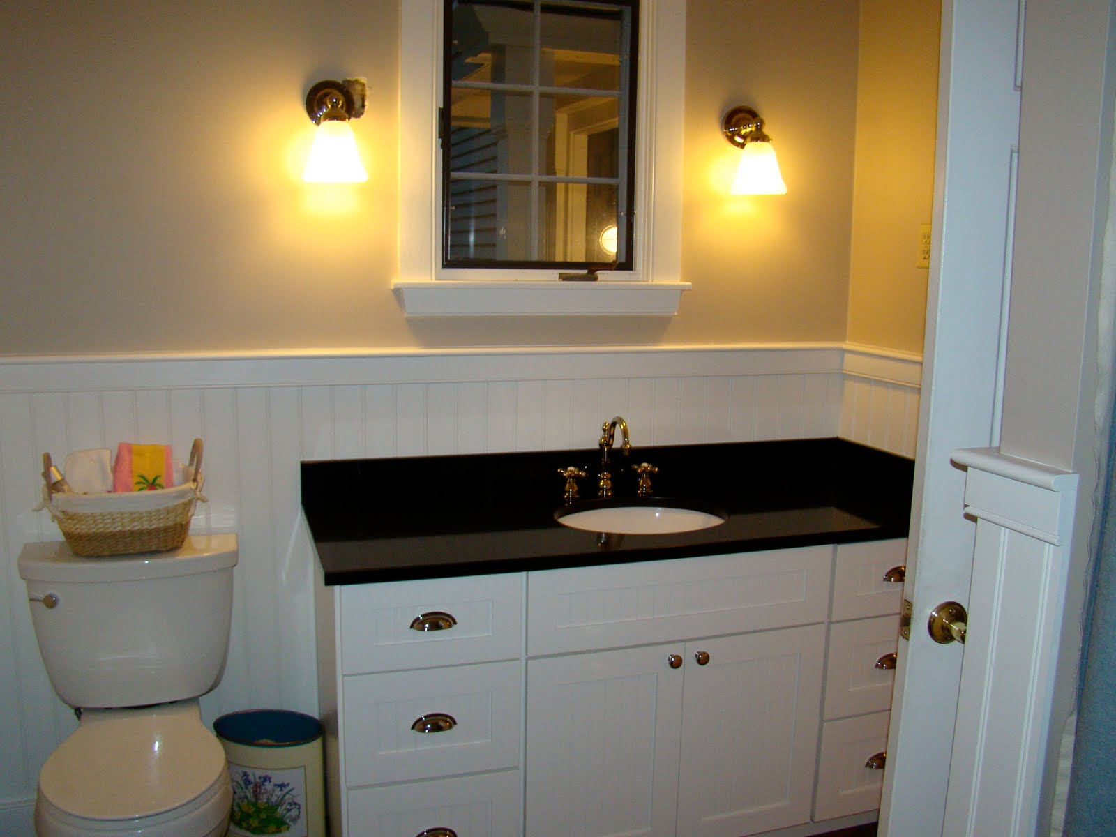 white wooden bathroom vanities with tops before the cream wall with white wainscoting and mirror plus lighting for bathroom decor ideas
