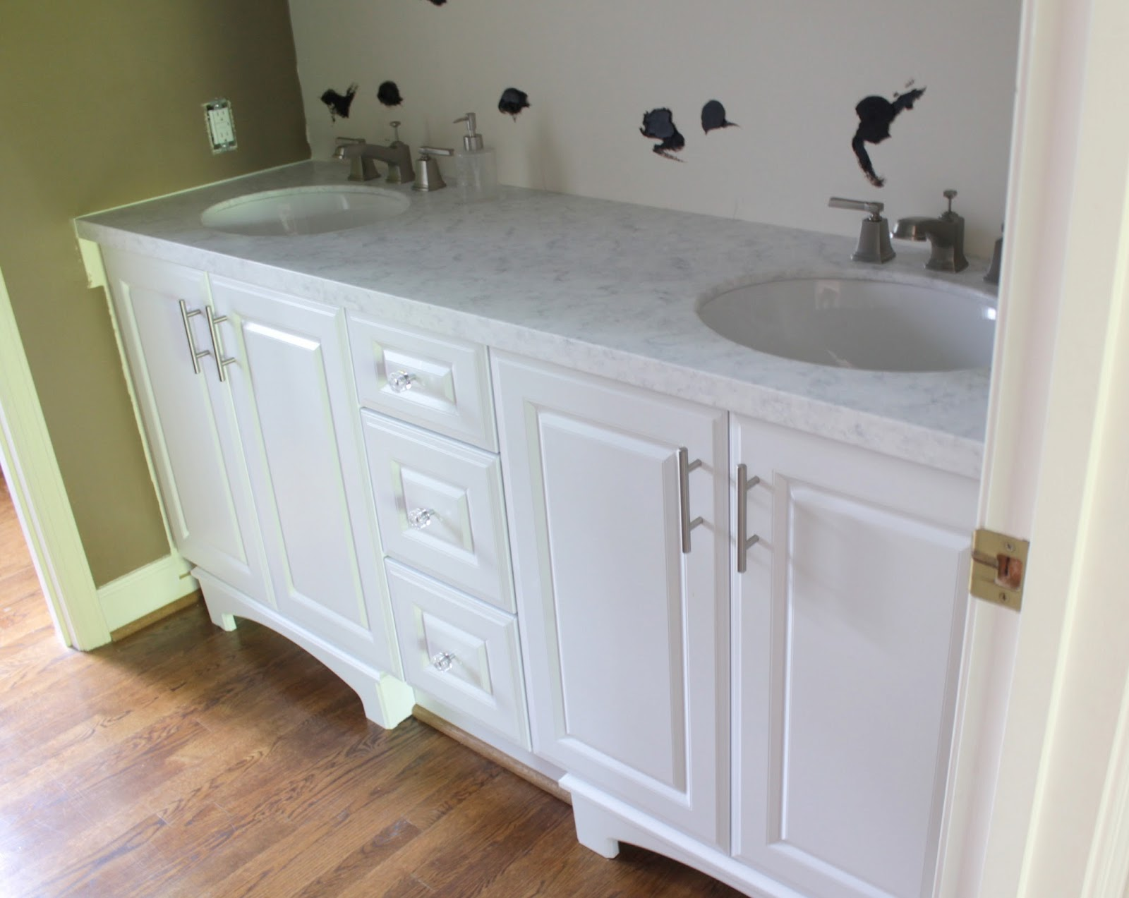 white wooden bathroom vanities with tops with silver handle and double sinks and faucets on wooden floor matched with white wall for bathroom decor ideas
