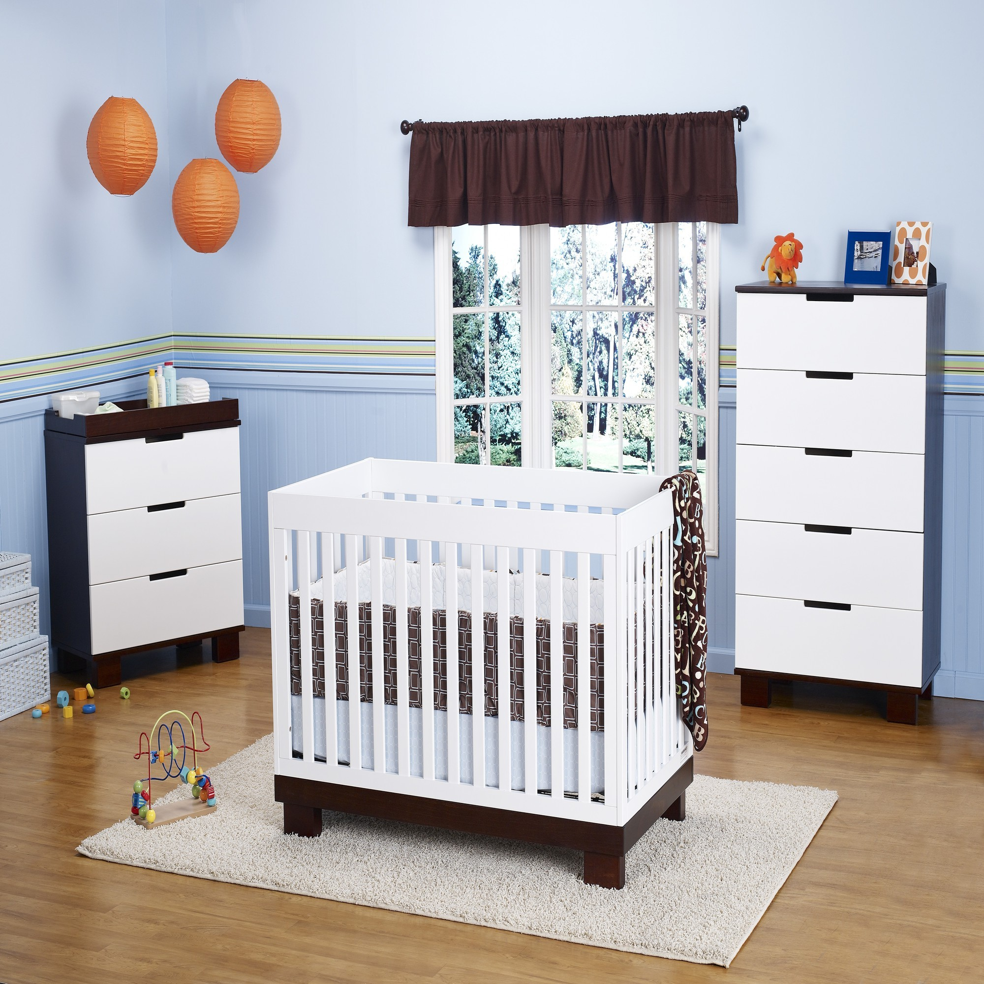 White Wooden Crib By Babyletto On White Carpet On Wooden Floor Matched With Blue Wall Plus Cabinet For Nursery Decor Ideas