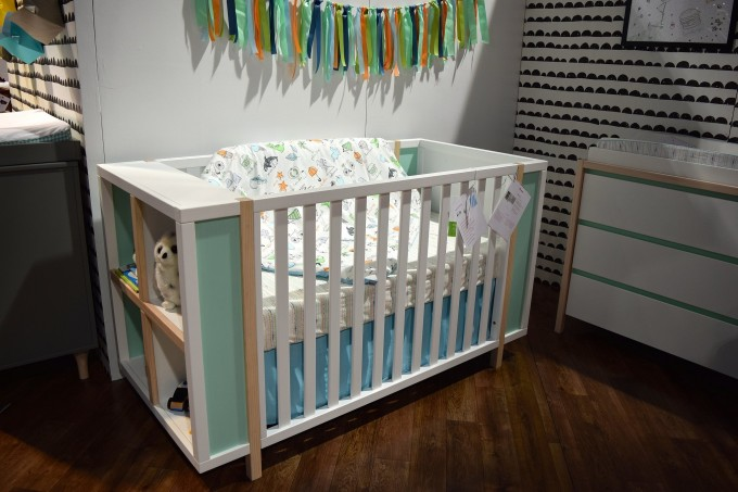 White Wooden Crib With Racks In Soft Green Theme By Babyletto On Wooden Floor Matched With White Wall Plus Cabinet For Nursery Decor Ideas
