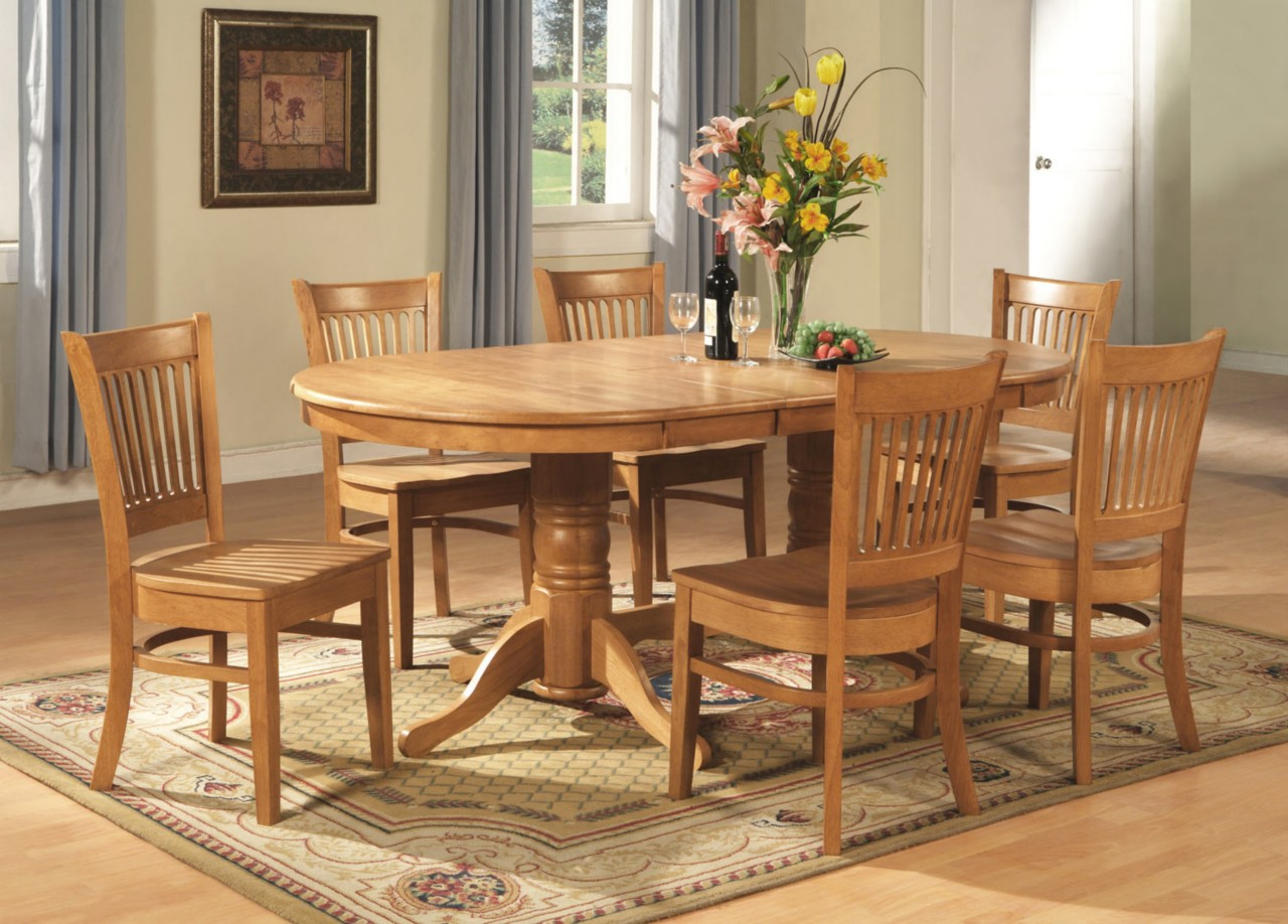 Lovely Wooden Expandable Dining Table Set With Oval Table On Wooden Floor Plus  Carpet Matched With White