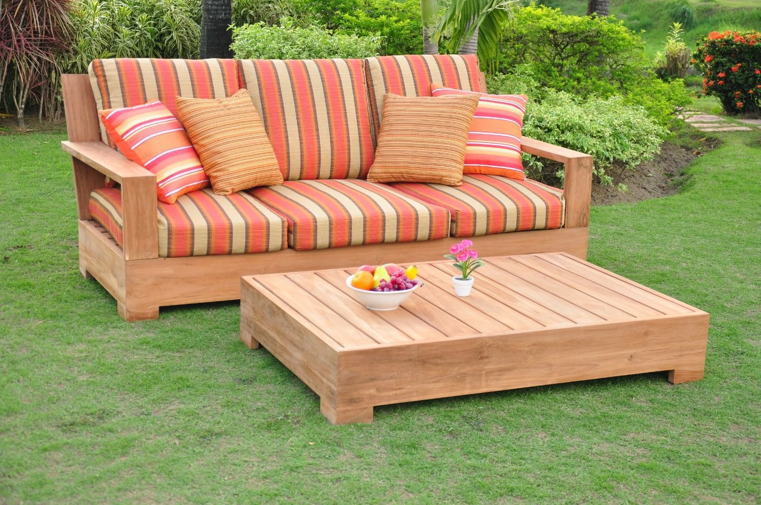 Wooden Sofa With Stripped Orange And Cream Sunbrella Cushions Plus Rectangle Wooden Table On Green Grass For Patio Decor Ideas