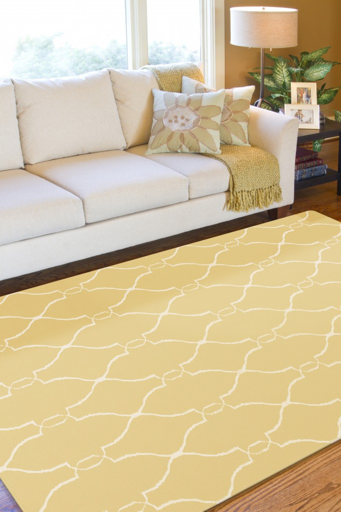 Yellow Surya Rugs On Wooden Floor Plus White Sofa Plus Cushions For Inspiring Living Room Decor Ideas