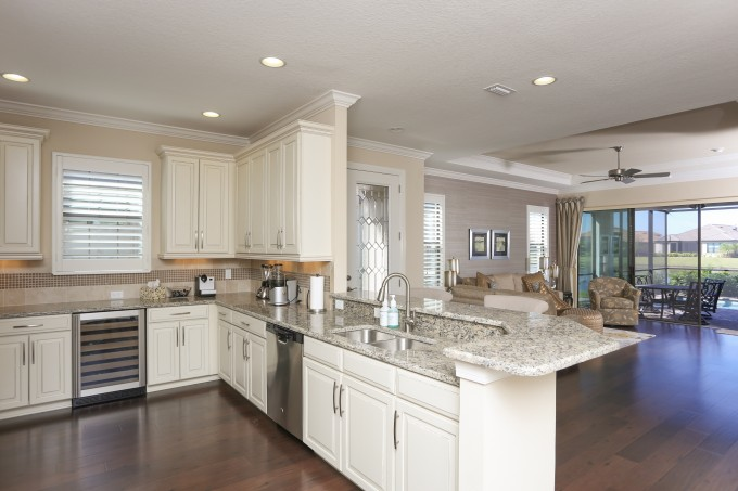 Amazing Kitchen American Woodmark Cabinets In White With Granite Countetop And Double Bowl Sink Plus Oven On Wooden Floor For Kitchen Decor Ideas