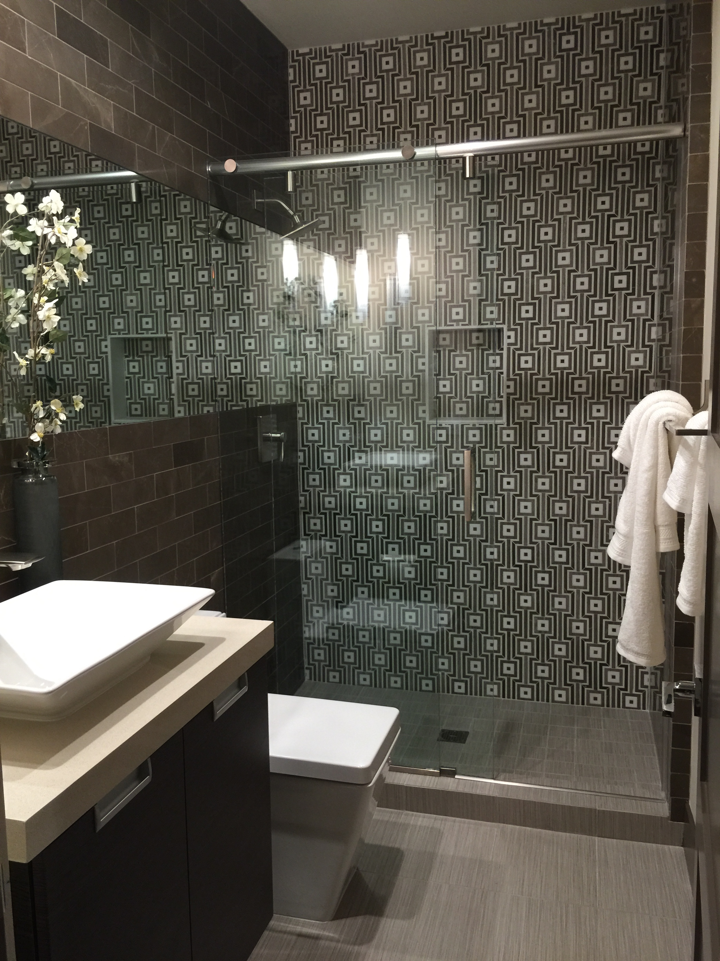 amazing tile wall by Walker Zanger plus frameless shower door and sink plus faucet for bathroom decor ideas