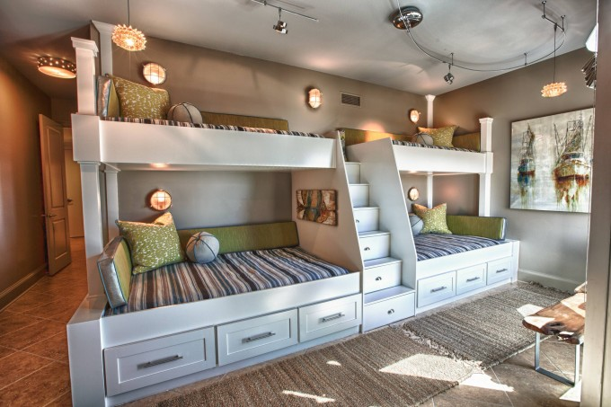 Amazing Wood Bunk Beds With Stairs In White With Storage And Stripped Bedding Before The Tan Wall With Light For Teen Bedroom Decor Ideas