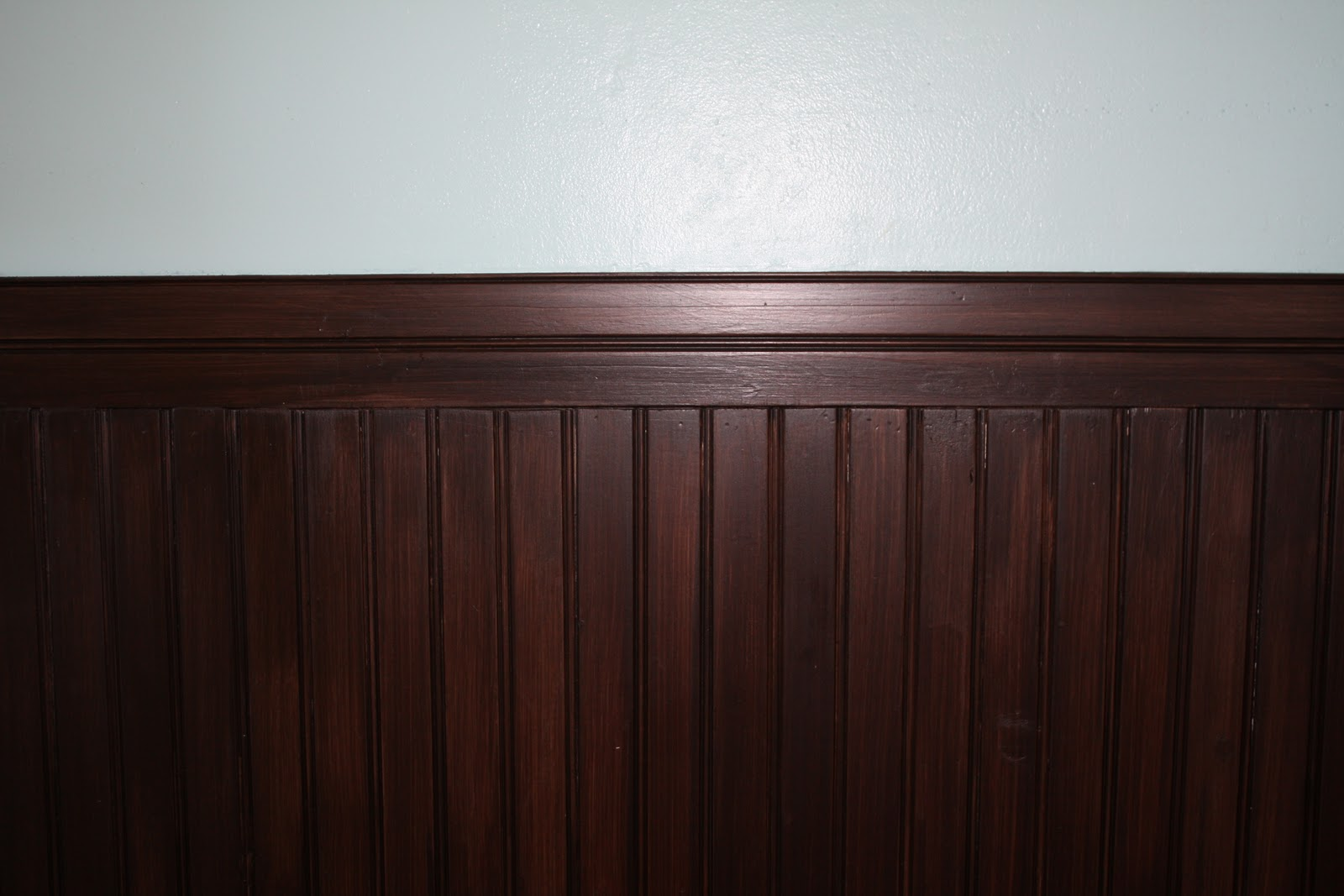 awesome brown wooden wainscoting using minwax gel stain matched with white wall for home interior design ideas