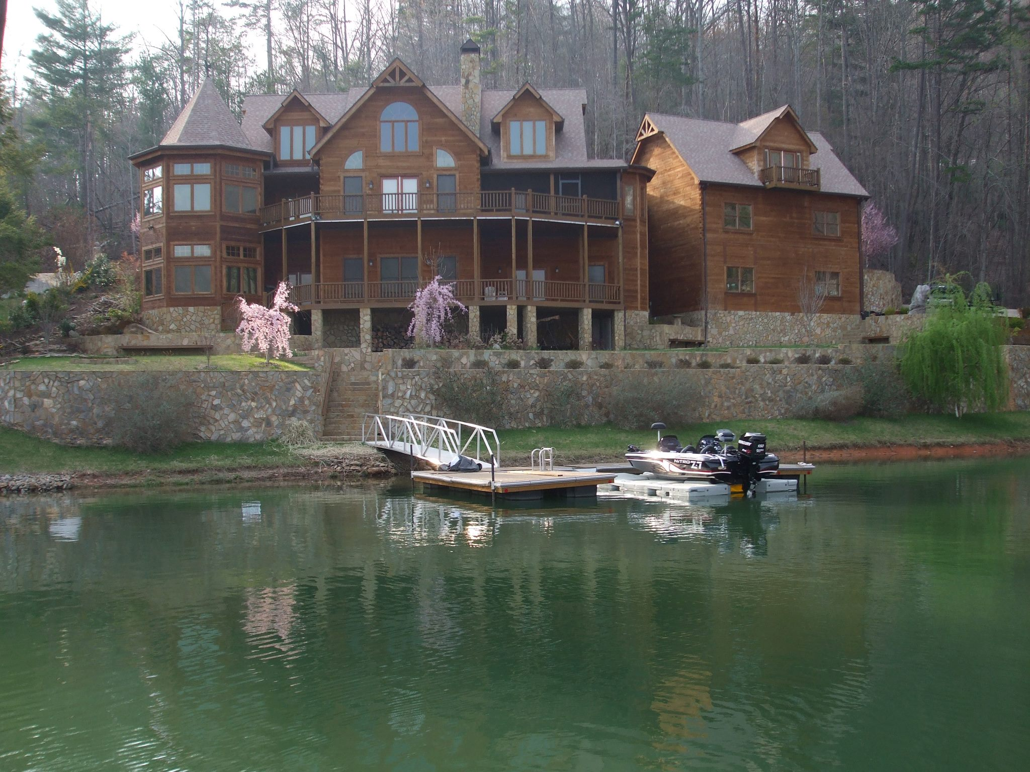 awesome exterior design of Southland Log Homes with glass window and brown roof ideas