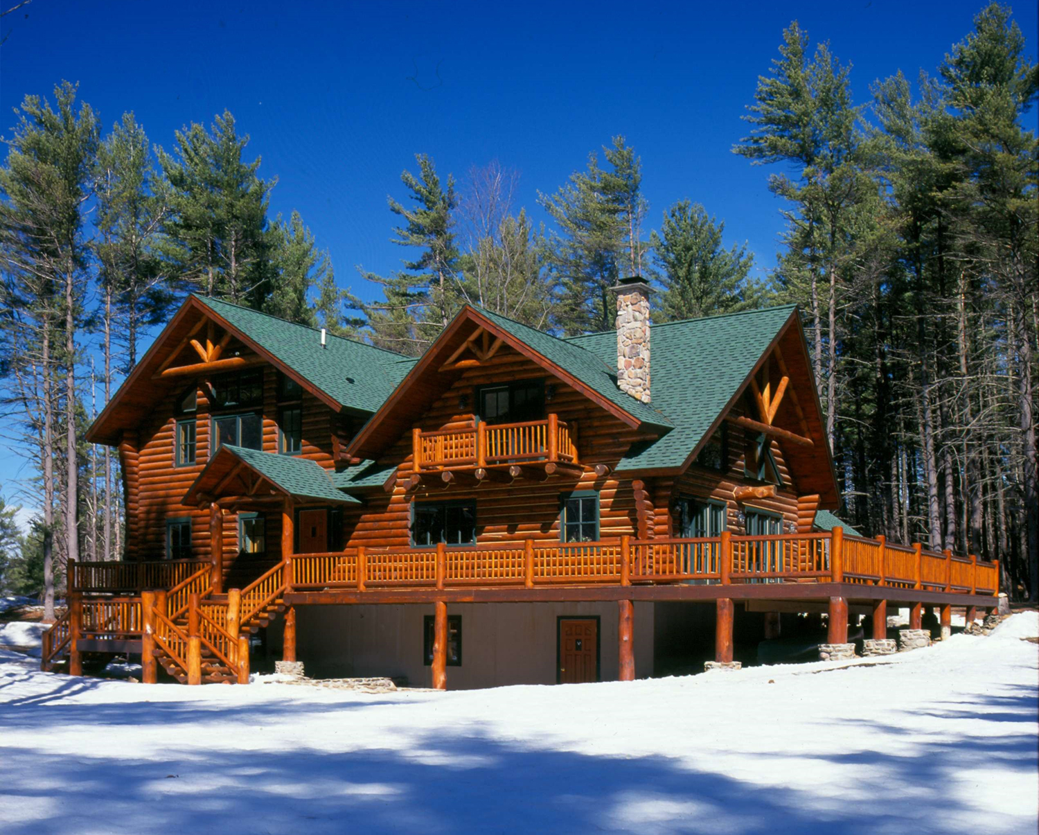 awesome exterior design of Southland Log Homes with green roof and single hung windows plus railing ideas